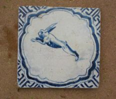Antique tile with hare