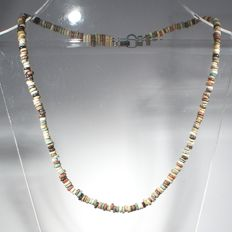 Necklace of red, white, turquoise and black faience discoid beads.