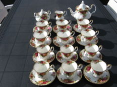 12 Cups and saucers, sugar bowl and creamer set, teapot, Royal Albert Old Country Roses.