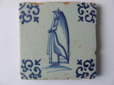 Antique tile with a Chinese and cape