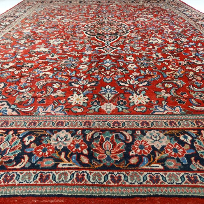 """Sarough – 390 x 297 cm. - """"Oversidzed Persian rug - Richly decorated - In beautiful used condition"""" - With certificate."""