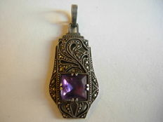 A silver pendant in the Art Deco style with an amethyst and marcasites