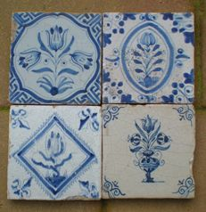 Lot of 4 antique tiles with flowers