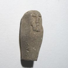 Egyptian unfired clay ushabti. H. 30 mm