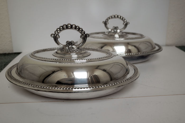 A matching set of two silver plated oval serving dishes by Maxfield & Sons, Sheffield, England, late 19th century