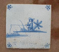 Antique tile with a fisherman!
