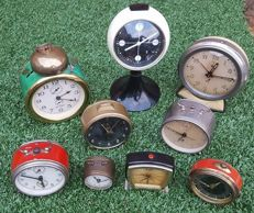 Collection of 9 old and antique alarm clocks, all mechanical