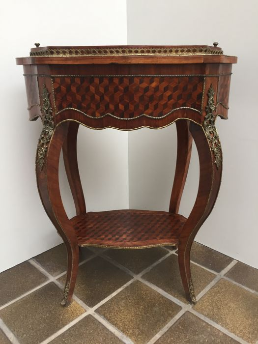 A Louis XV style gilt bronze mounted tulipwood and kingwood parquetry jardinière - France - circa 1870
