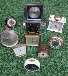 Collection of 10 old and antique alarm clocks, all mechanical