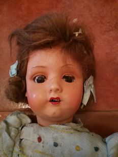 Vintage papier-mâché dolls and baby doll