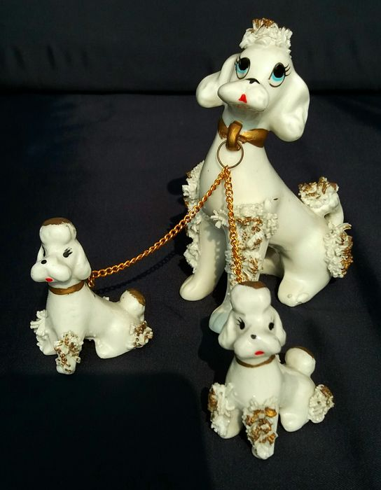 Finely hand-painted enamelled porcelain poodles
