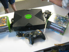 Xbox including 1  controller and  15 games like: Brute force , need for speed , lord of the rings , batman and more