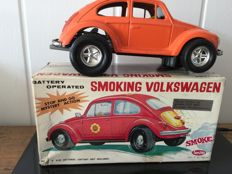 "Aoshin, Japan - Length 27 cm - Tin ""Smoking Volkswagen"" with battery engine, 1970s"