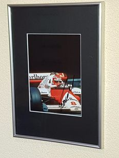 Niki Lauda - 3x Worldchampion Formula 1 -  hand signed framed photo + COA.