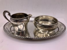 A 3 pieced hammered silver cream set - Germany - 20th century