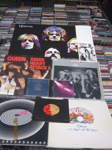 large Queen collection: 4 lp's,1 single,4 cd's,1 painting (canvas),30 new postcards and one big flag (170cmx100cm)