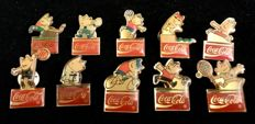 A collection of 10 , vintage , Coca Cola , advertising pins , made in 1980´s for Olympic Games Barcelona 1992