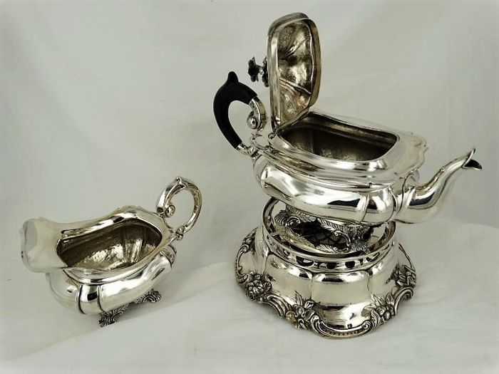 a silver biedermeier teapot and milk jug jacobus van vorst rotterdam 1847 on silver chafing. Black Bedroom Furniture Sets. Home Design Ideas