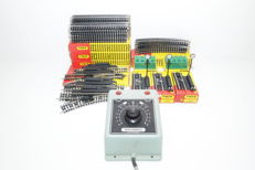 Trix Express H0 - 4304/4312/6596/4369/4361/4362/5599 - 41 piece lot with new rails and used transformer.