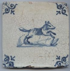 Antique tile with a depiction of 'a dog'