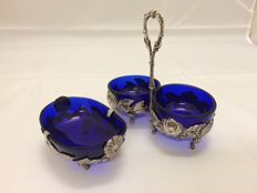 A silver pepper, salt and mustard set, with blue glass inserts - circa 1900