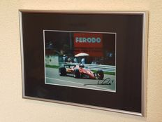 Mario Andretti - Worldchampion Formula 1 - Ferrari - hand signed framed photo + COA.