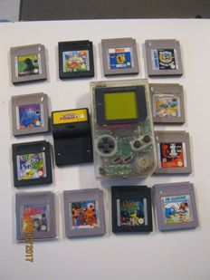 Clear original Nintendo Gameboy including 13 games like: Bust a Move 4. F1, Tetris, Godzilla, Pokemon Pinball,etc