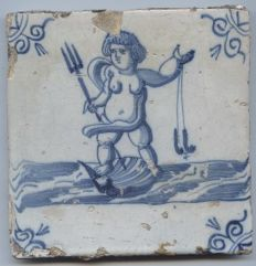 Antique tile with the depiction of a female sea creature standing on a large shell