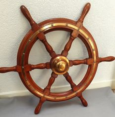 Old mahogany steering wheel with brass mounts