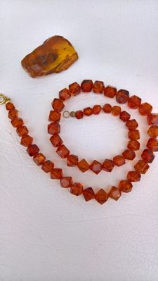 Baltic amber with Empididae insect inclusion 37.8 mm x 28,2 mm x 10,36 mm and Baltic Amber Necklace (2)