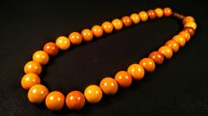 Vintage modified Baltic Amber Egg yolk colour necklace, length 50 cm, 64 grams