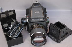 Mamiya M645 single-lens reflex with additional viewfinder and film holder