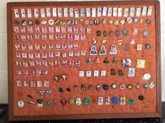 Football - Collection of 175 different football pins on wooden frame.