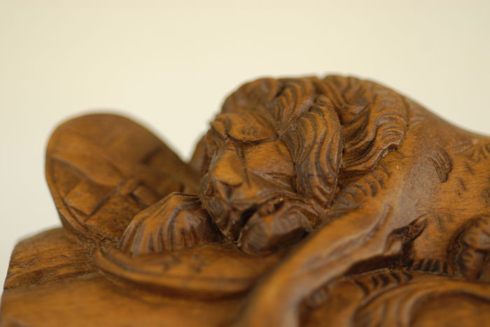 Wood carving 'the dying lion of lucerne switzerland