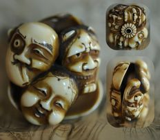 Ivory carved manju netsuke of 7 noh masks - Japan - 19th century (late Edo period)