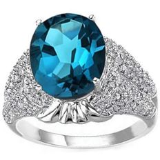 14K White  Gold Ring With 7.9 Grams -  Blue  Topaz and 0.28 ct Diamonds - US Size 7.5