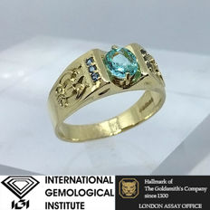 Paraiba Brazilian Tourmaline Natural 0.71ct IGI certified set on a solid 14kt gold Assay certified Ring-size 10.5