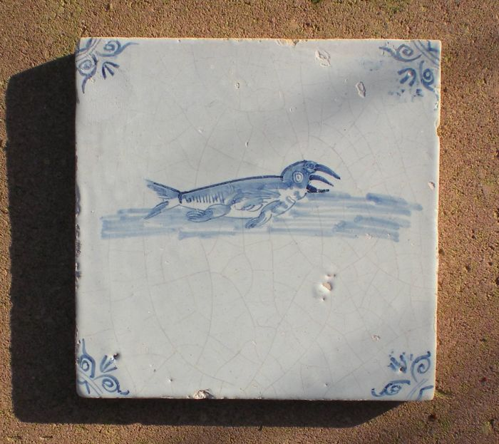 Antique tile with a depiction of a walrus, oxen head corner motif, special depiction