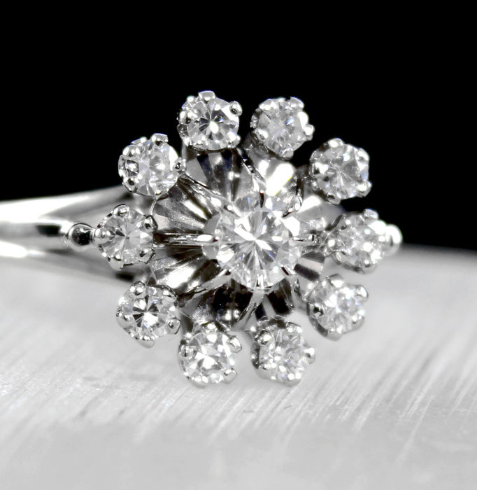 White gold 18 kt cluster engagement ring – Center brilliant diamond 0.35ct , & 10 smaller Diamonds, total diamonds weight of 0.85ct. Size 6.5