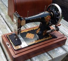 Very old but decorative Singer sewing machine with wooden cover,1896