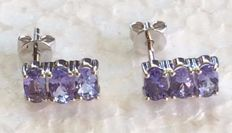 14 kt white gold natural tanzanite earrings set with 3 x single stones ; stone is 5 x 3 mm