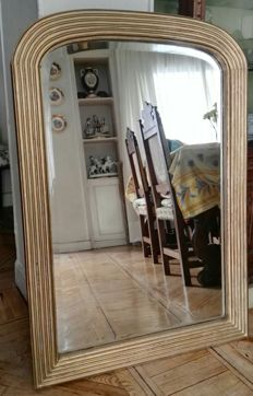 Bevelled mirror with gilded frame 110 x 75 cm