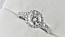 1.57 ct  round diamond ring in 14 kt white gold - size 7.5