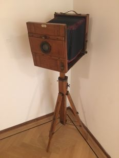 Wooden plate camera with wooden tripod