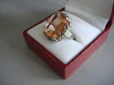Jugenstil silver ring, with a large high orange-salmon-coloured  stone in an engraved setting