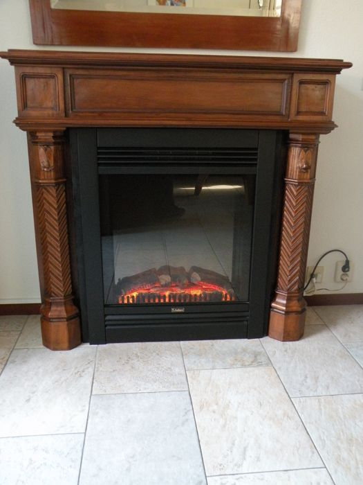 Walnut (display front) hearth with electric fireplace, circa 1900