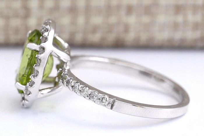 3 03 carat peridot and 14k solid white gold ring
