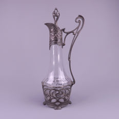 Large Art Nouveau glass decanter with pewter frame in whip motives