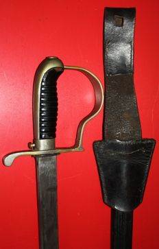 Original Sabre of the Dutch police, maker: W.K.C in good condition, complete with leather sheath, and frog, in good to very good condition