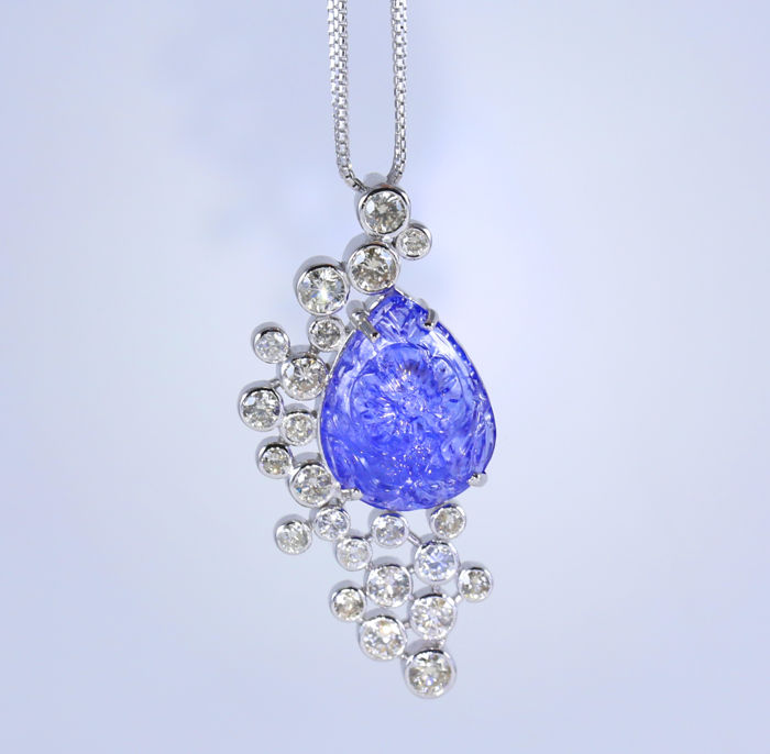 IGI Certified White Gold Very Unique large 16.75 ct. Floral Carved Pear shape Tanzanite and 4.80 Ct. diamonds Pendant Necklace